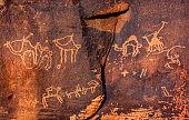 Anicent Camel Petroglyphs Wadi Rum Valley of the Moon Jordan.  Inhabited by humans since prehistoric times, place where TE Lawrence of Arabia in the early 1900s.  Petroglyphs were used to guide carava