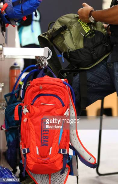 CamelBak Products LLC brand backpacks hang on display during the Outdoor Retailer Summer Market Show in Salt Lake City Utah US on Saturday July 29...