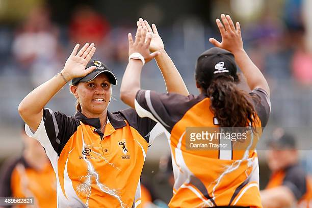 Camella Gray and Tabatha Saville of the Northern Territory celebrate a wicket during the Imparja Cup final between the Northern Territory and New...