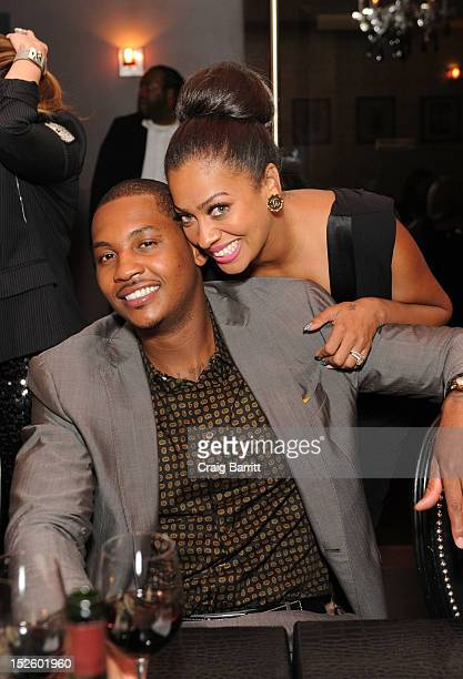 Camelo Anthony and La La Anthony attend the HauteTimecom celebration of their ambassador and partner Carmelo Anthony at STK on September 22 2012 in...