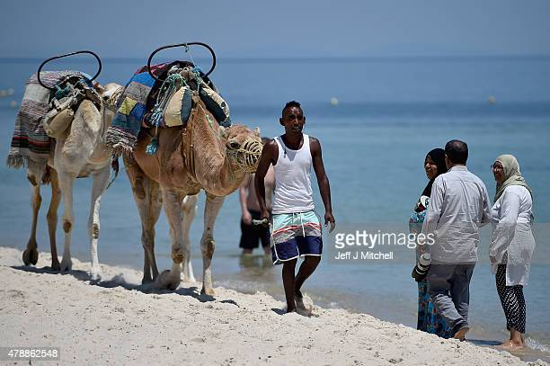 Camels are walked along Marhaba beach where 38 people were killed on Friday in a terrorist attack on June 28 2015 in Souuse Tunisia Sousse beaches...