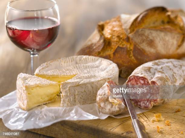 Camembert,dried sausage,bread and a glass of red wine