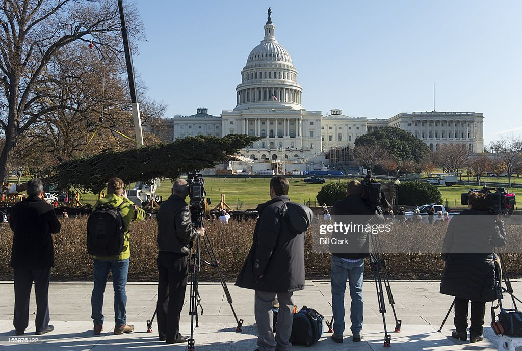 TV camera crews cover the arrival of the U.S. Capitol Christmas Tree on Monday, Nov. 26, 2012. The tree lighting ceremony will be held the evening of December 4th on the West Front of the Capitol.