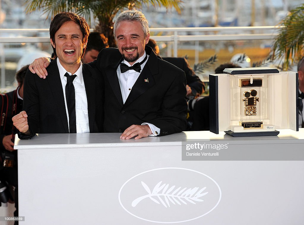 Camera D'Or Jury President <a gi-track='captionPersonalityLinkClicked' href=/galleries/search?phrase=Gael+Garcia+Bernal&family=editorial&specificpeople=202025 ng-click='$event.stopPropagation()'>Gael Garcia Bernal</a> (L) and winner of the Camera D'Or award for the film 'Ano Bisiesto' director Michael Rowe attend the Palme d'Or Award Ceremony Photo Call held at the Palais des Festivals during the 63rd Annual International Cannes Film Festival on May 23, 2010 in Cannes, France.