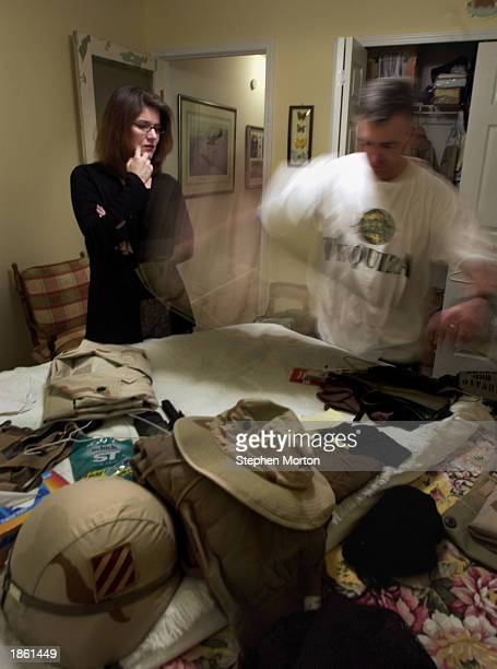 A camera effect shows Noel Nicolle packing his personal duffle bag in a spare bedroom while his wife Tamara watches before he departs for the Middle...