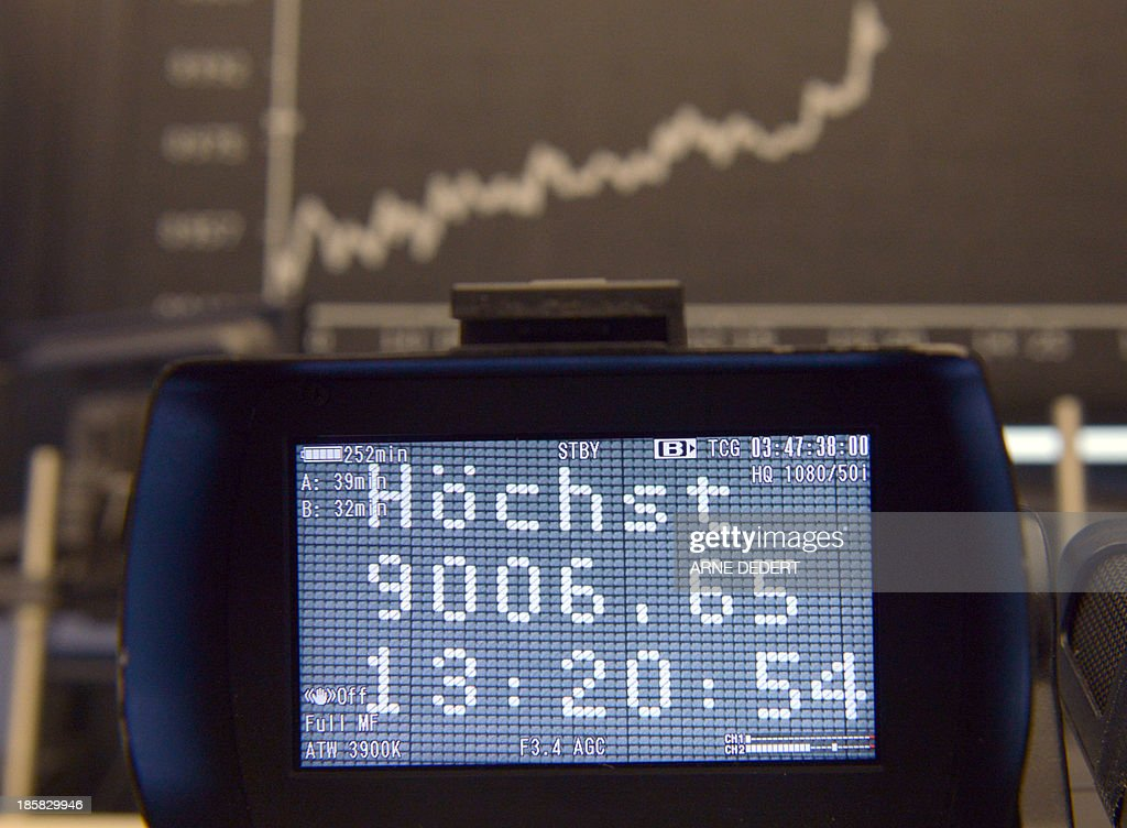 A TV camera films the display showing the German stock market index DAX at the stock exchange in Frankfurt am Main, central German on October 25, 2013. Germany's DAX stock index set a new all-time high when it briefly topped 9,000 points.