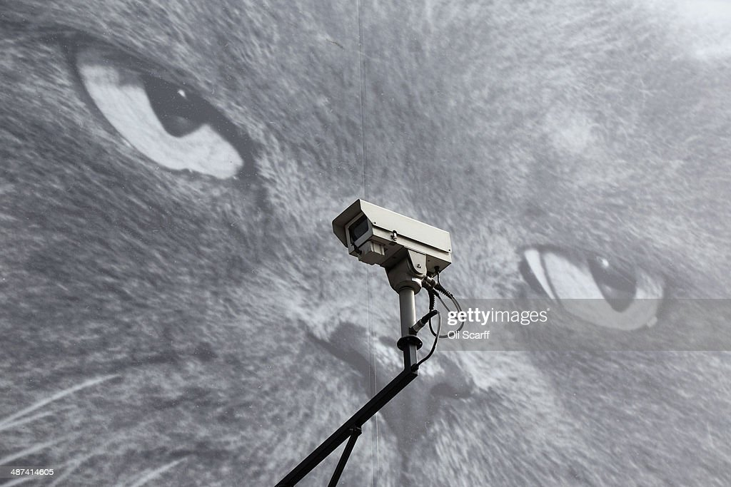 CCTV camera is positioned in front of a giant poster of a cat on April 30 2014 in London England Privacy campaigners have stated that Town halls in...