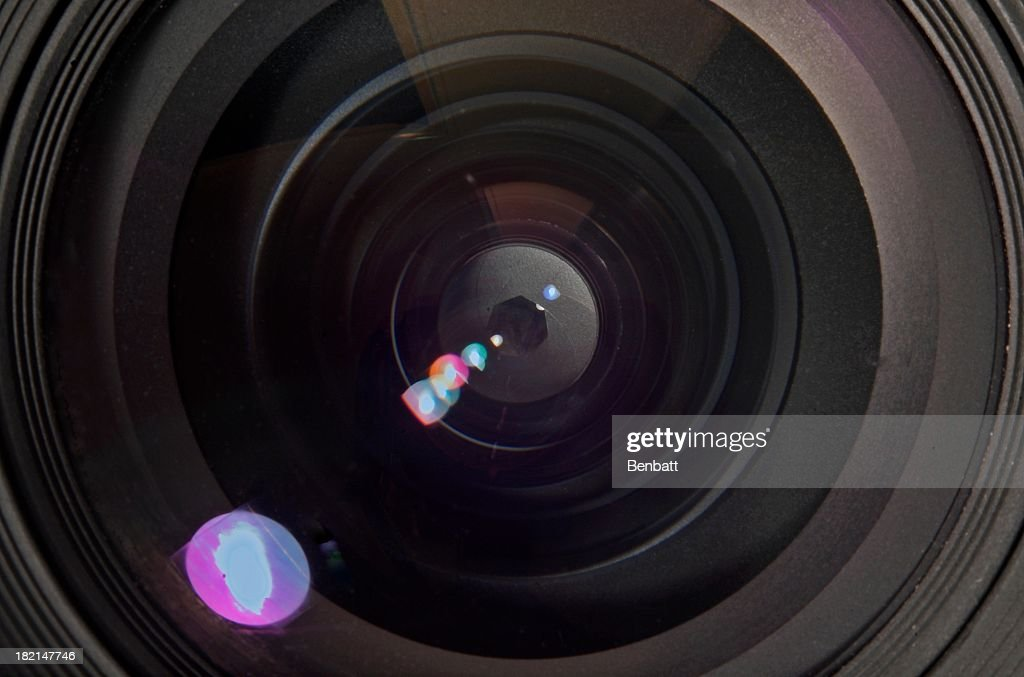 Camera lens aperture with refracted light : Stock Photo