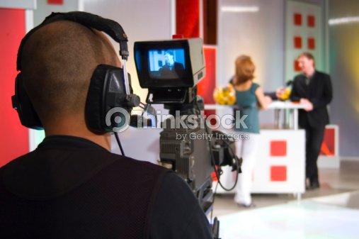 Camera man filming in TV studio : Stock Photo