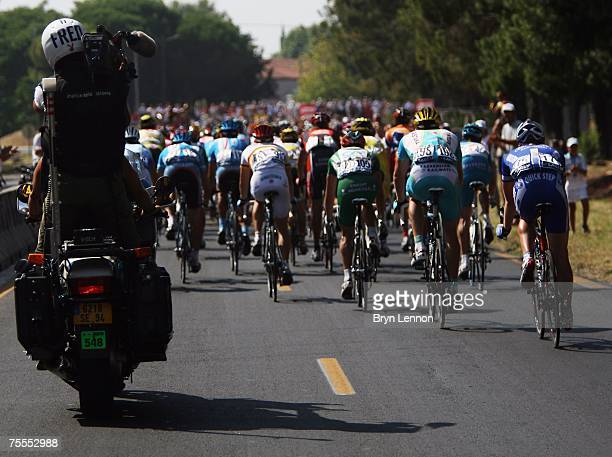 TV camera man films the riders on stage 11 of the 2007 Tour de France from Marseille to Montpelier on July 19 2007 in Montpelier France