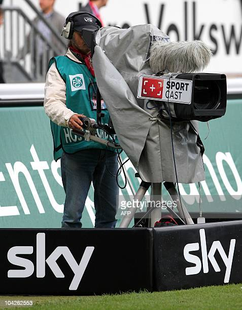 DFL A camera man of German pay tv media company sky is seen during the German first division Bundesliga football match between 1 FC Kaiserslautern...