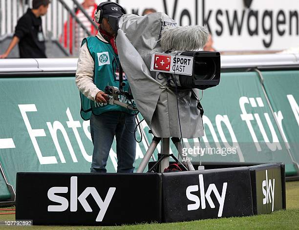A camera man of German pay tv media company sky is seen during the German first division Bundesliga football match between 1 FC Kaiserslautern and...