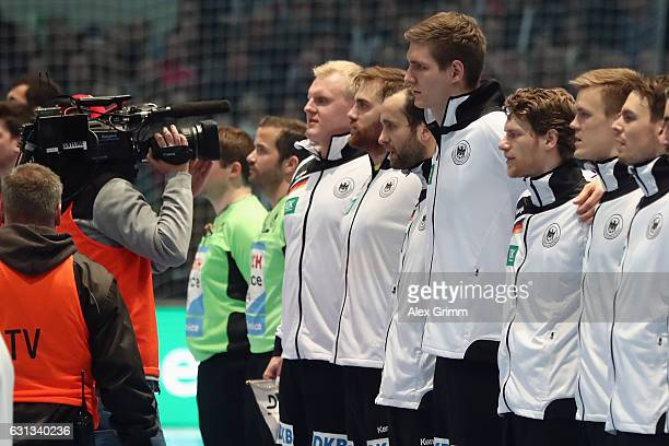 TV camera man walks past the german team prior to the international handball friendly match between Germany and Austria at RothenbachHalle on January...
