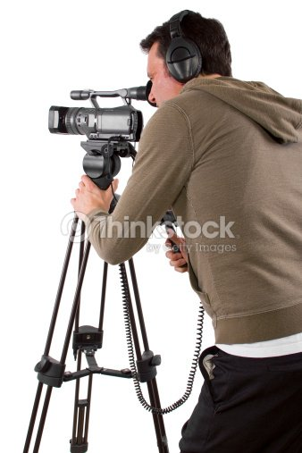 Camera Man Wearing Headphones with a Camera and Tripod : Stock Photo