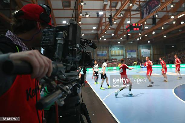 TV camera man works at the sideline during the international handball friendly match between Germany and Austria at RothenbachHalle on January 9 2017...