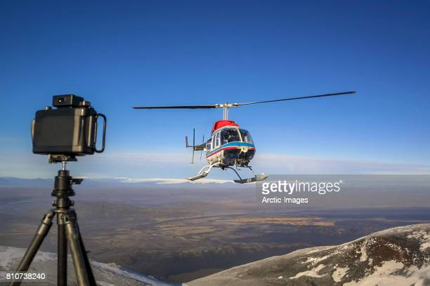 Camera on tripod with Helicopter