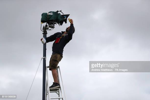 A camera operator wipes rain from his lens during day one of The Open Championship 2017 at Royal Birkdale Golf Club Southport