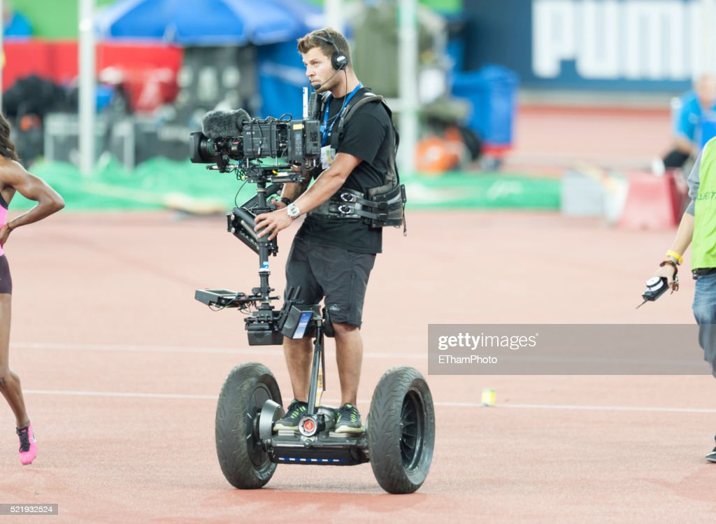 Camera operator standing on a Segway and equipped with Steadicam camera stabilizing system during the Weltklasse Zurich athletics event in Zurich's (Switzerland) Letzigrund stadium on August 29, 2013.