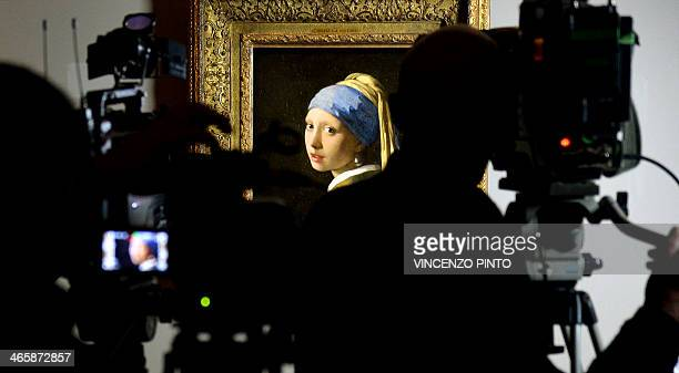 Camera operators film the masterpiece 'Girl with a Pearl Earring' by Dutch painter Johannes Vermeer during a preview of the exhibition 'The Myth of...