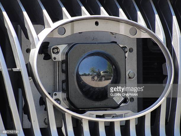 A camera peers out from the front grill of Google's selfdriving car in Mountain View California on May 13 2014 A white Lexus cruised along a road...