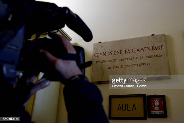 A camera person films a plaque outside the chamber of the parliamentary committee of supervision of audiovisual services during the hearing of the...