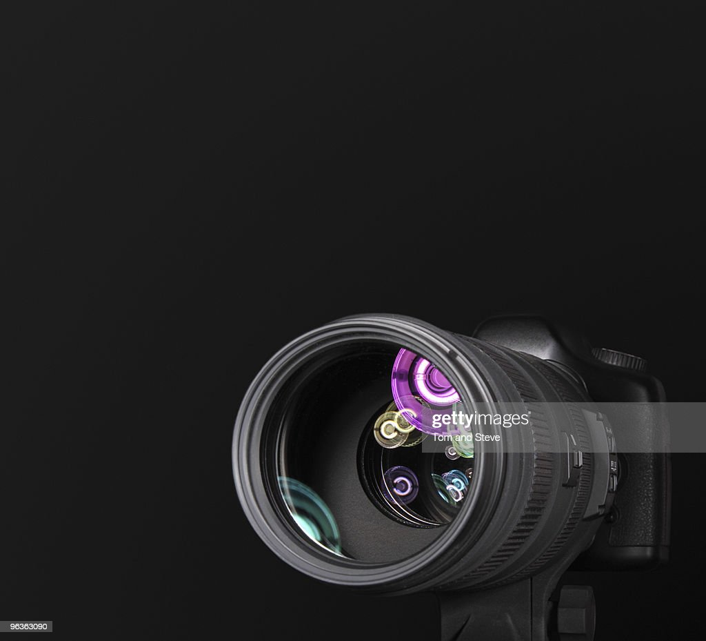 Camera with Telephoto lens and reflections : Stock Photo