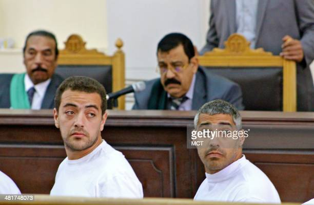 Cameraman Baher Mohamed left and Mohamed Fadel Fahmy the Cairo bureau chief for al Jazeera English look at reporters sitting behind them Monday March...