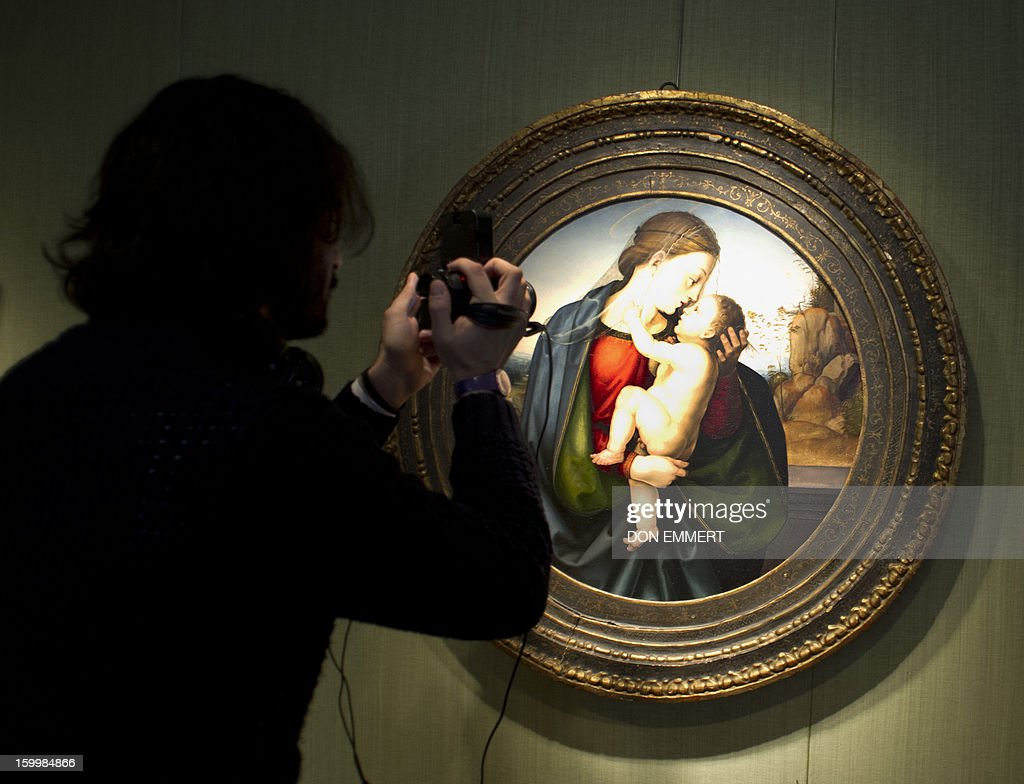 A cameraman does a close-up of 'The Madonna and Child' by Fra Bartolommeo January 24, 2013 at Christie's in New York. The painting is one of the works to be auctioned during Old Masters week, January 26-31, 2013. AFP PHOTO/DON EMMERT
