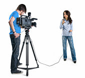 Cameraman filming a reporter, isolated on white background