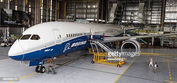 A cameraman films a Boeing Co 7879 Dreamliner test aircraft sitting in a hangar at Air New Zealand Ltd's technical operations base at Auckland...