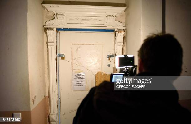 A cameraman films a door of the 'Fussilet 33' mosque in Berlin on which a note reading 'The mosque is permanently closed' is mounted on February 28...