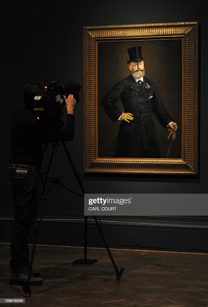 A cameraman films a painting by French artist Edouard Manet entitled 'Portrait of M. Antonin Proust' at the Royal Academy of Arts in central London on January 22, 2013. Forming part of the 'Manet: Portraying Life' exhibition, it is due to be displayed from January 26 to April 14.