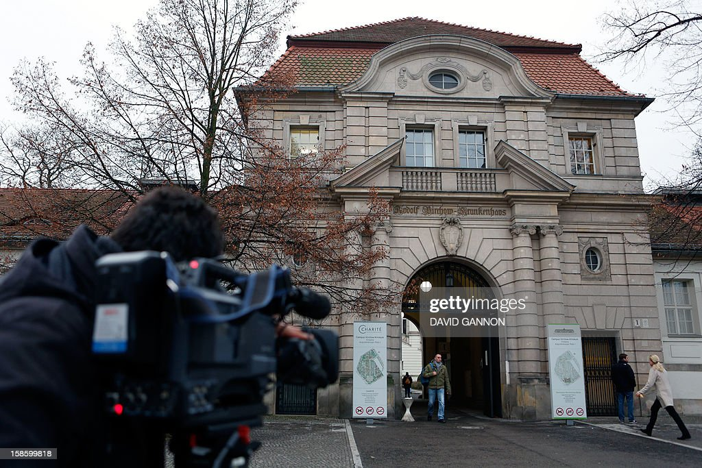 A cameraman films as people enter the Virchow campus of the Charite, one Europe's largest university hospitals, on December 20, 2012 in Berlin. Iraqi President Jalal Talabani, a key figure who has long sought to bridge bitter divides in his war-scarred country, arrived in Germany on December 20, 2012 for treatment after he suffered a stroke. A spokeswoman for Berlin's Charite said he was receiving treatment there but declined to provide further details. GANNON