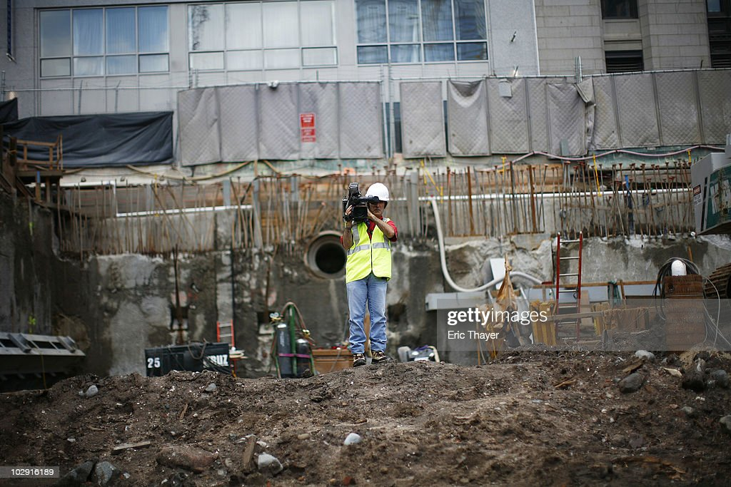 A cameraman films as workers examine remnants of what is thought to be an 18th century ship at the site Ground Zero Construction Site in July 15, 2010 New York City. The wood hulled vessel is approximately 30 feet long and was found 20 to 30 feet below street level on Tuesday morning.