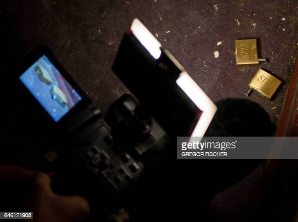 A cameraman films broken locks in the 'Fussilet 33' mosque in Berlin on February 28 2017 German authorities have closed a radical mosque in Berlin...