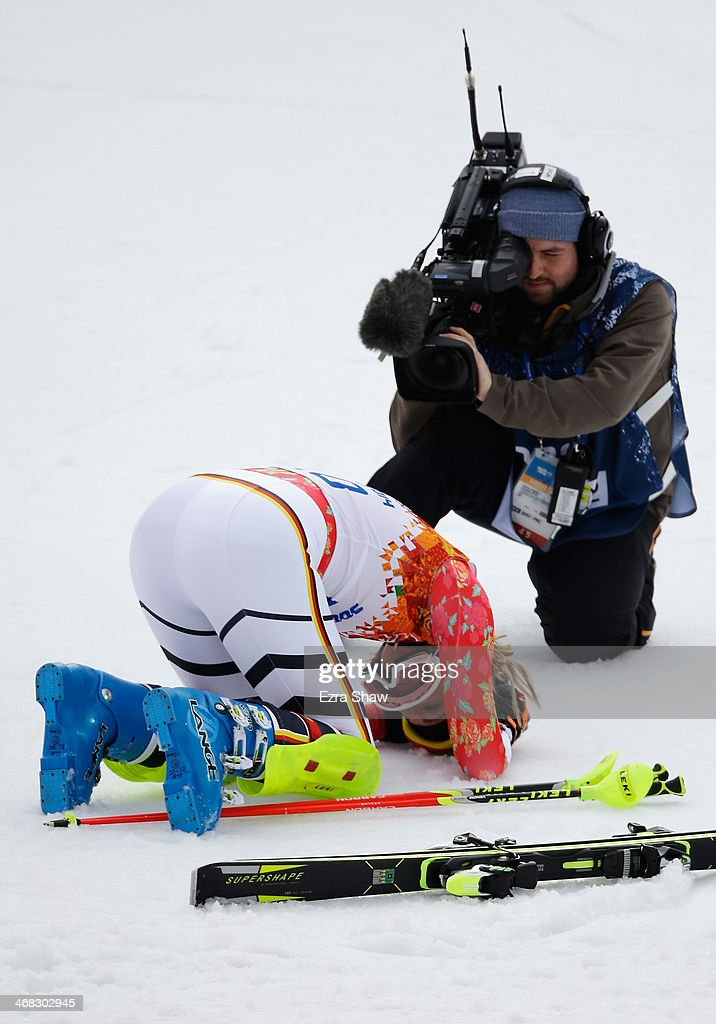 A TV cameraman films gold medalist <a gi-track='captionPersonalityLinkClicked' href=/galleries/search?phrase=Maria+Hoefl-Riesch&family=editorial&specificpeople=7648886 ng-click='$event.stopPropagation()'>Maria Hoefl-Riesch</a> of Germany as she reacts during the Alpine Skiing Women's Super Combined Slalom on day 3 of the Sochi 2014 Winter Olympics at Rosa Khutor Alpine Center on February 10, 2014 in Sochi, Russia.