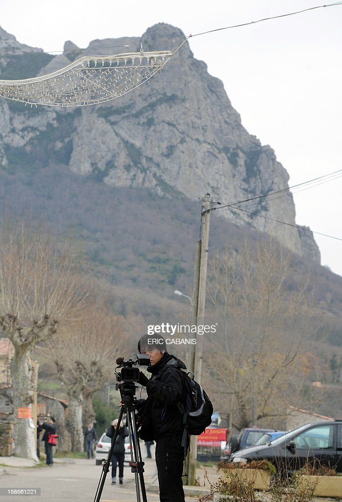 A cameraman films on December 19, 2012, a street of the southwestern French village of Bugarach near the 1,231 meter high peak of Bugarach, one of the few places on Earth some believe will be spared when the world ends on December 21, the end of an era that lasted over 5,000 years, according to the Mayan 'Long Count' calendar. French authorities have pleaded with New Age fanatics, sightseers and media crews not to converge on the tiny village.