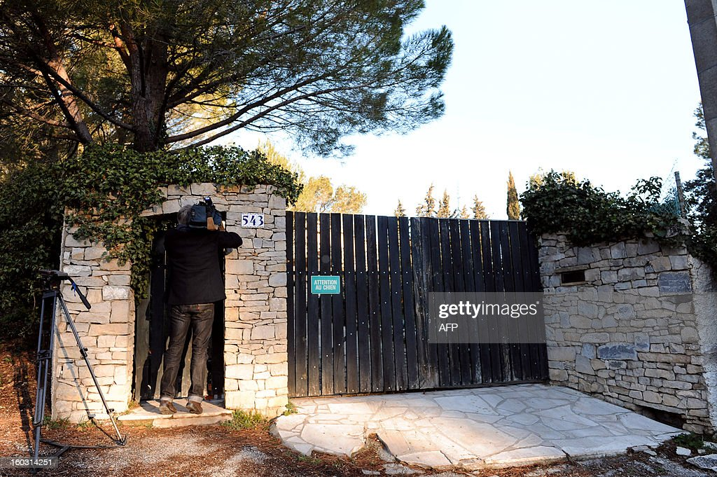 A cameraman films on January 29, 2013 in Courbessac, south eastern France, the home of a British man arrested today as part of the inquiry into the murder of a female jogger, whose body was found on January 24, 2013 in Courbessac.