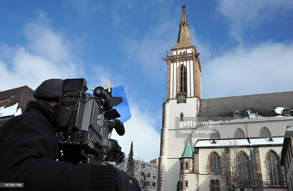 A cameraman films outside of Muenster St. Jakobus church as a memorial service is held for 14 people who died in a fire at a Caritas employment facility for the handicapped on December 1, 2012 in Titisee-Neustadt, Germany. The fire was reportedly caused by an explosion at the facility, where approximately 120 people with disabilities are employed in light manufacturing.