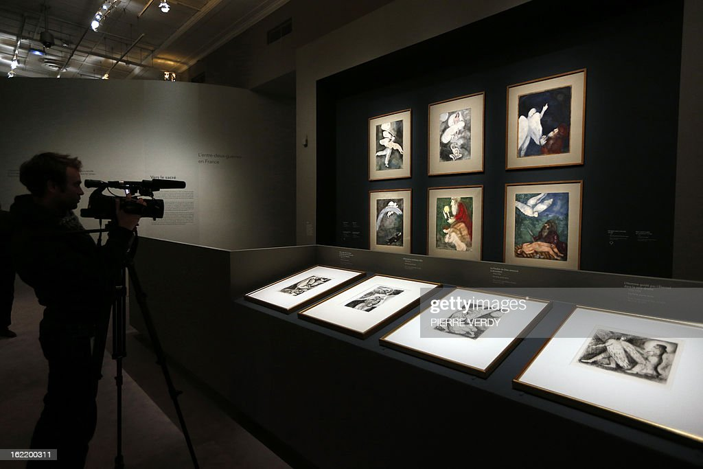 A cameraman films painting by Russian-born and naturalized French painter Marc Chagall, during an exhibition entitled 'Between war and peace', on February 20, 2013 at the Museum of Luxembourg in Paris. The event will be held from February 21 until July 21, 2013.