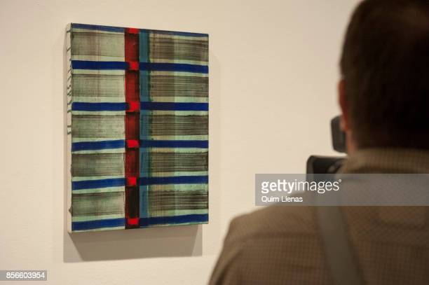 A cameraman films the Paint 'Seven Thirty' by Juan Usle during the press preview of the exhibition 'Punto de Encuentro' at the Reina Sofia Museum on...
