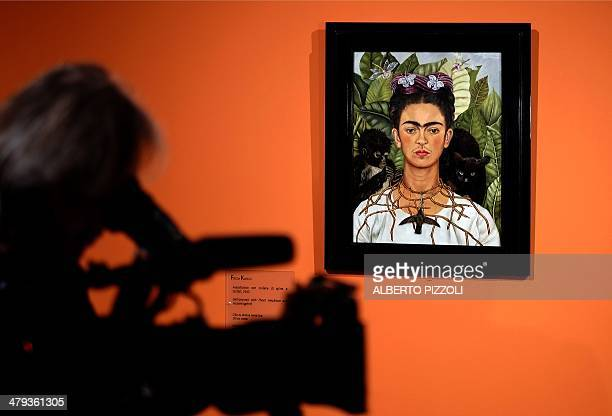 A cameraman films the 'Selfportrait with with Thorn Necklace and Hummingbird' by Mexican artist Frida Kahlo during an exhibition in Rome's Scuderie...