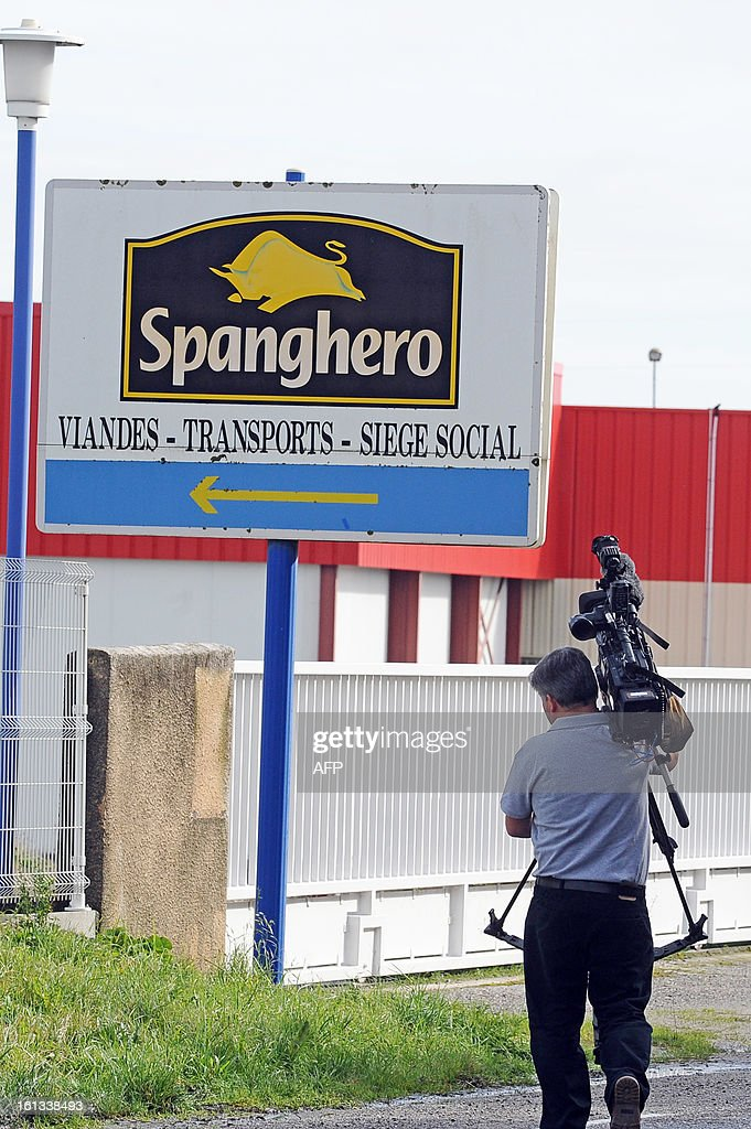 A cameraman from Britain films the sign of Spanghero, a French meat food industrial factory, at the entrance of the plant in Castelnaudary, southeastern France, on February 10, 2013. A Europe-wide food fraud scandal over horsemeat sold as beef deepened on February 9, 2013 as Romania announced an inquiry into the origin of the meat and suspicions of criminal activity mounted.
