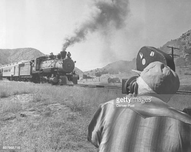 Cameraman Jack Marta takes a sighting as a steam locomotive borrowed from John Birmingham of Boulder races down canyon Locomotive engineer in the...