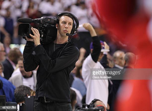 Cameraman Mark Utley works play between the Brooklyn Nets and the Toronto Raptors in Game Five of the NBA Eastern Conference Quarterfinals at the Air...