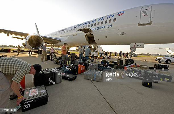 CNN Cameraman Peter Morris checks his camera gear before loading it onto a chartered North American Airlines Boeing 757 freshly painted with new...