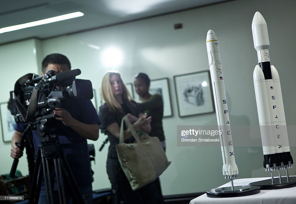 A TV cameraman records a model of SpaceX's Falcon Heavy rocket after a news conference at the National Press Club April 5, 2011 in Washington, DC. <a gi-track='captionPersonalityLinkClicked' href=/galleries/search?phrase=Elon+Musk&family=editorial&specificpeople=4448862 ng-click='$event.stopPropagation()'>Elon Musk</a>, CEO of Space Exploration Technologies Corp (SpaceX) and Tesla Motors, held the news conference to announce SpaceX's Falcon Heavy rocket which could complete missions to the International Space Station and Moon and should be ready for use by the end of 2012.