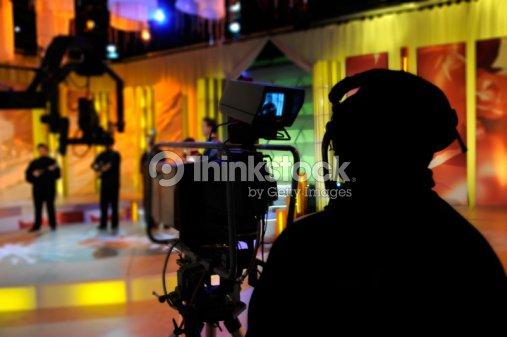 Cameraman records show in a TV Studio : Stock Photo