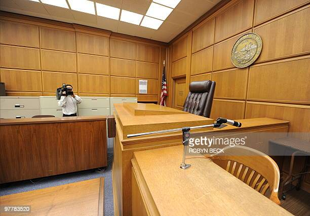 A cameraman records the judge's podium in a courtroom closed due to budget cuts and layoffs at the Stanley Mosk Courthouse in downtown Los Angeles on...