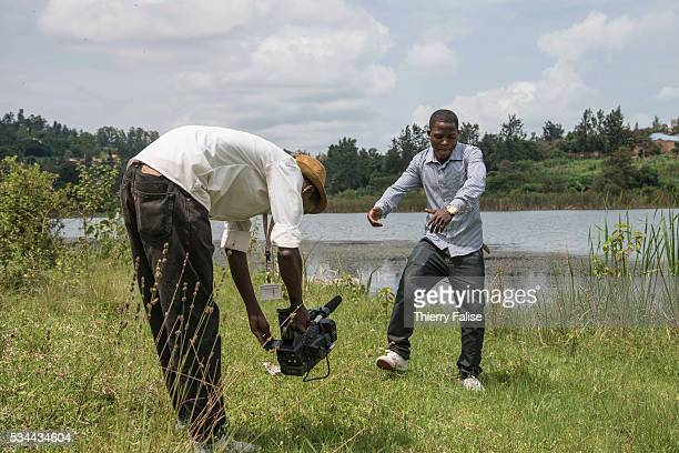 A cameraman shoots a video clip of a singer along a small lake in Kigali Kigali with a population of more than one million is Rwandas capital and...
